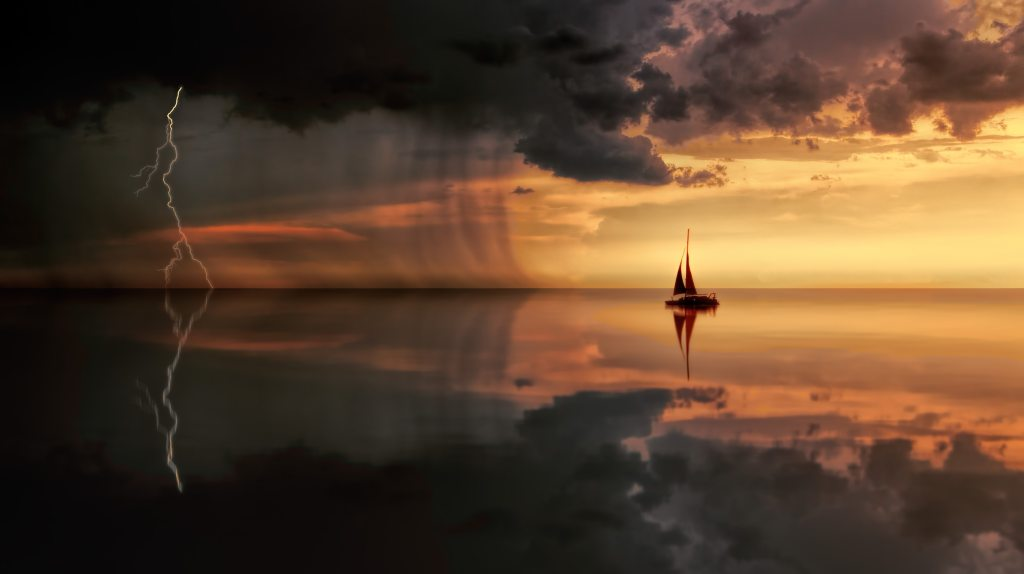Boat Sails Into Storm at Sunset