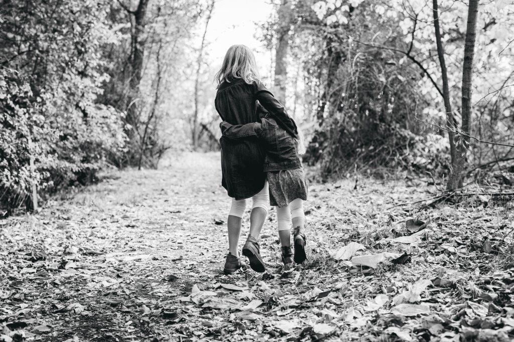 Two Little Girls Walk Down Path