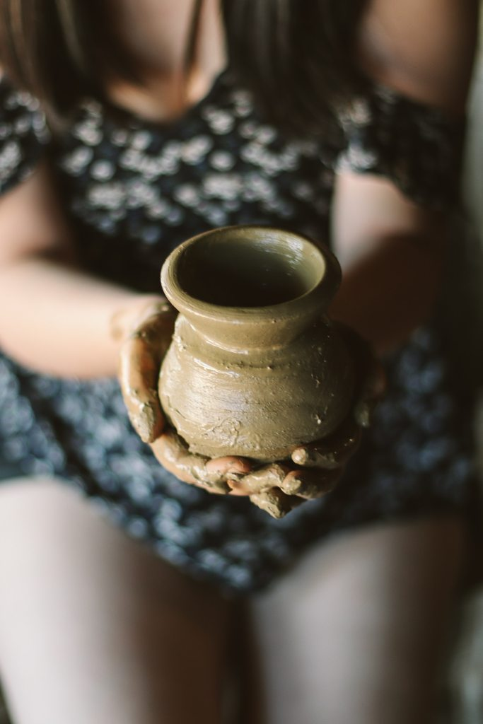 Woman Holding a Clay Pot