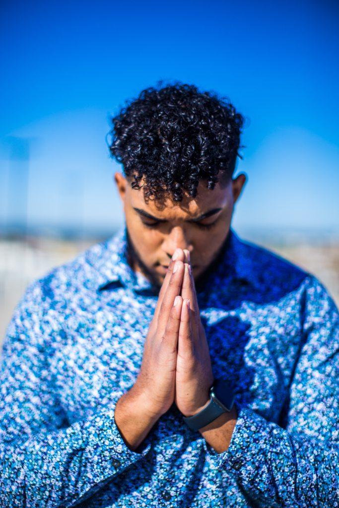 Man Praying Dutifully to God