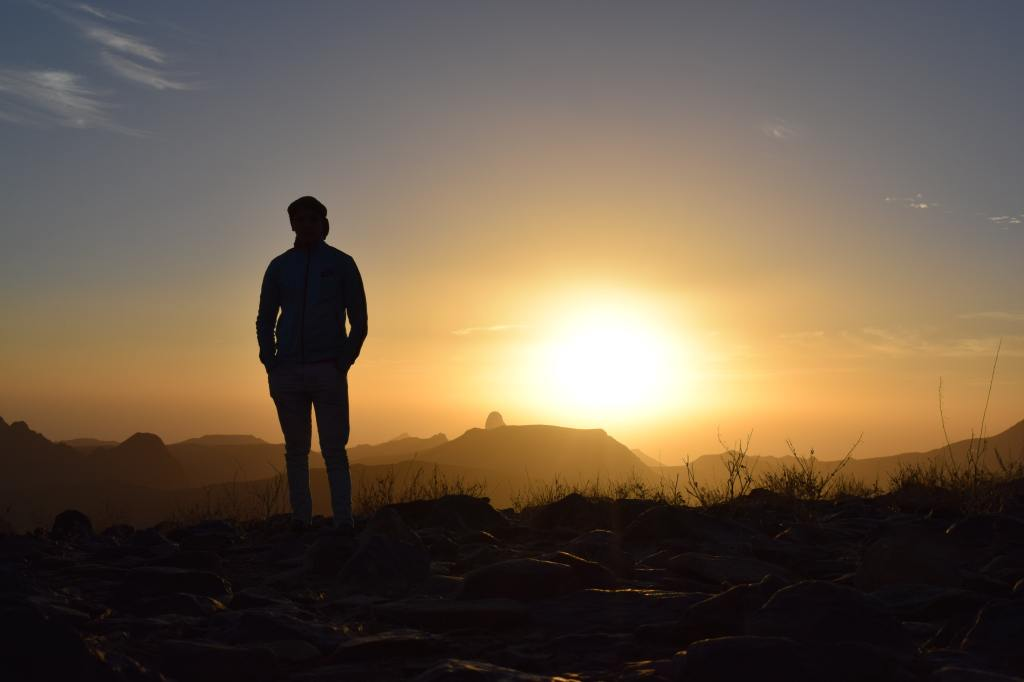 Person standing outside at sunset