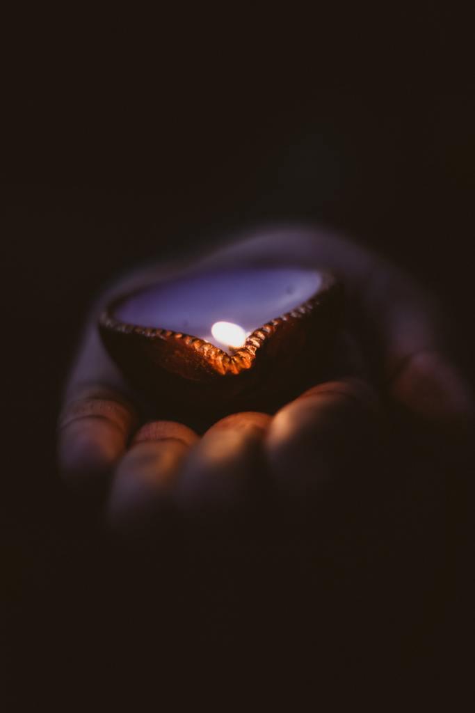 Oil Lamp in Hand